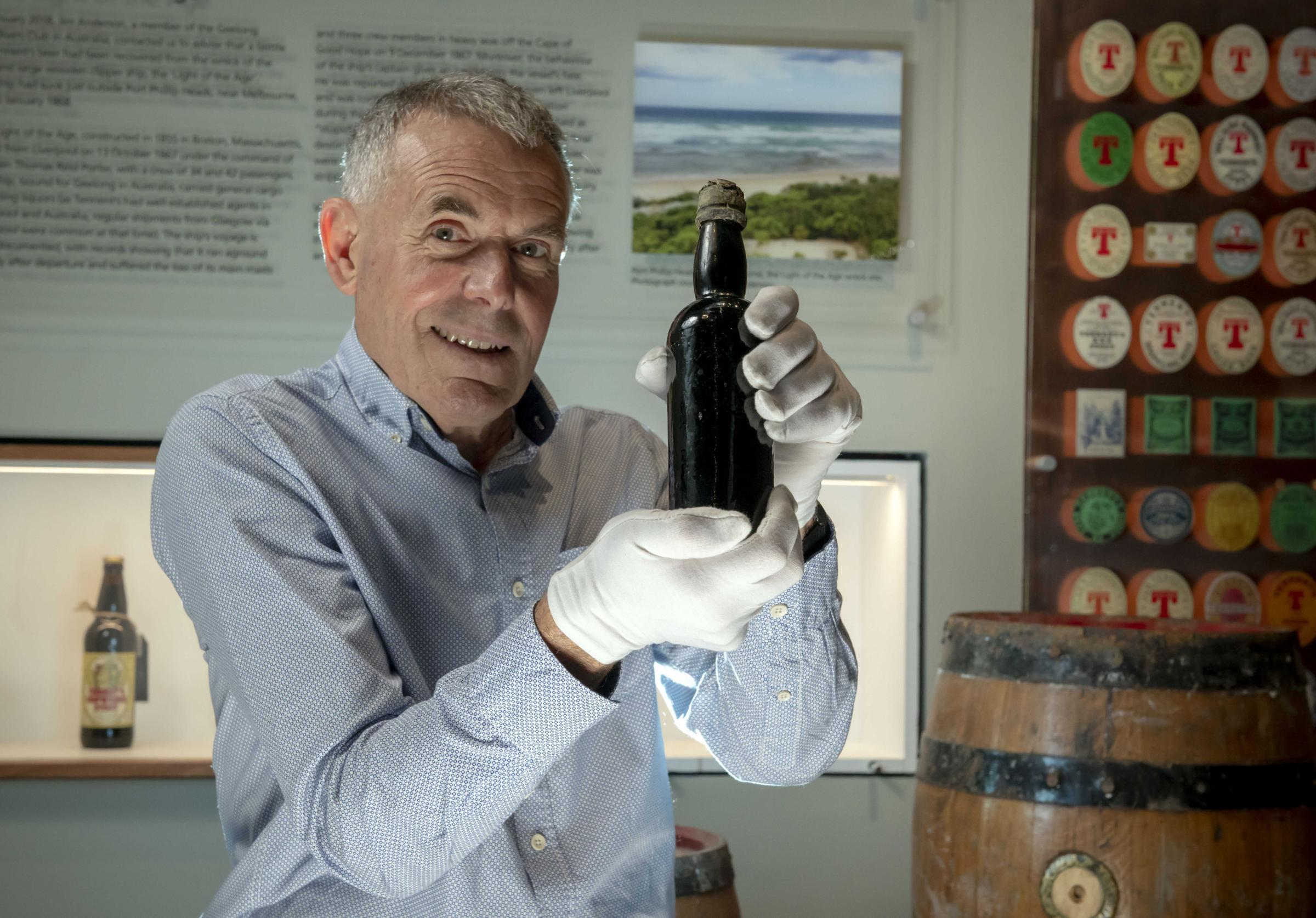 Diver Jim Anderson with a 150-year-old bottle of stout, produced by the firm best known for Tennent's Lager, set to return to Glasgow